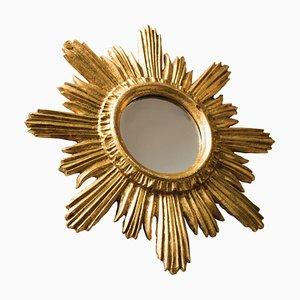 Specchio a forma di sole in legno dorato, anni '60