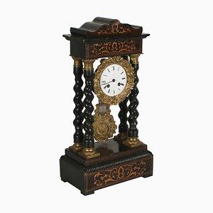 Reloj francés con incrustaciones y pórtico, siglo XIX
