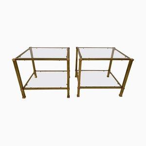 Mesas auxiliares vintage de latón y vidrio con dos niveles. Juego de 2