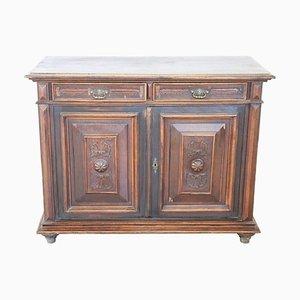 Mueble antiguo de castaño tallado, década de 1880