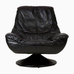 Butaca vintage de cuero negro, años 60
