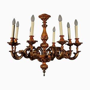 Lámpara de araña antigua de madera tallada
