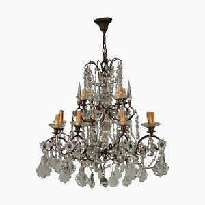 Lámpara de araña antigua de vidrio con ocho brazos