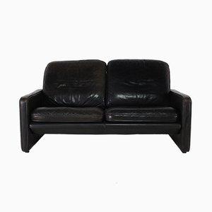 Sofá de dos plazas de cuero negro de de Sede, años 70