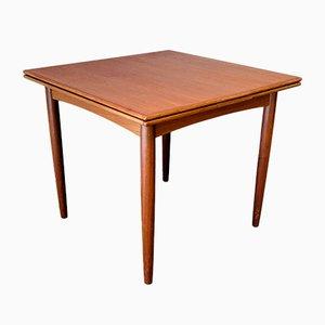 Mesa de comedor extensible de teca, años 60