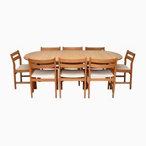 Juego de mesa y ocho sillas de comedor danés de roble, años 80
