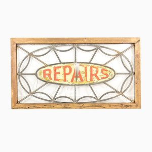 Cartel Repairs antiguo