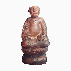 Figura taoísta china antigua de madera tallada