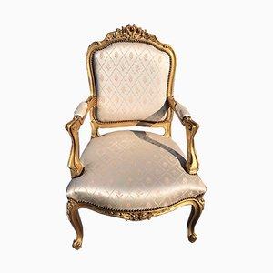 Butaca francesa Luis XV antigua de madera dorada tallada