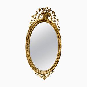 Espejo antiguo ovalado tallado y dorado