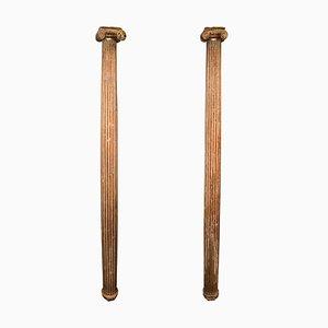 Columnas italianas de madera tallada y dorada, siglo XVII. Juego de 2