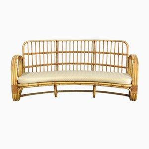 Sofá de ratán curvado, años 60