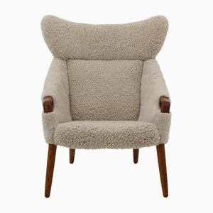 Modell 55 Sessel aus Teakholz & Schafsfell von Kurt Østervig für Rolschau Mobler, 1950er