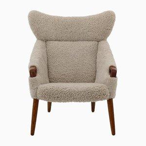 Teak & Sheepskin Model 55 Lounge Chair by Kurt Østervig for Rolschau Mobler, 1950s