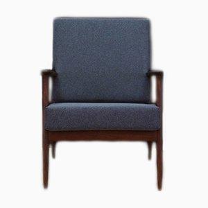 Dänischer Vintage Sessel aus Stoff und Teakholz, 1970er