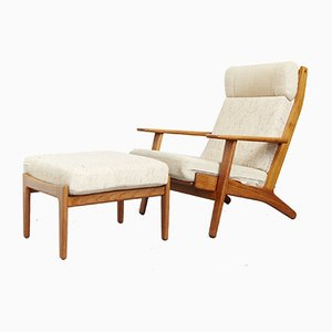 Scandinavian Teak Lounge Chair and Ottoman by Hans J. Wegner for Getama, 1960s, Set of 2