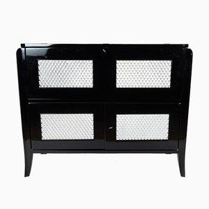 Mueble bar negro con incrustaciones de plata de Jean Pascaud, años 30