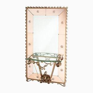 Espejo grande biselado con marco de hierro forjado y consola de vidrio, años 30