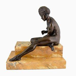 Art Deco Skulptur einer Frau mit Würfel aus Bronze von Clarisse Levy Kinsbourg