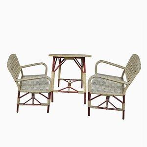 Juego de mesa y dos sillas Art Déco de mimbre, años 30