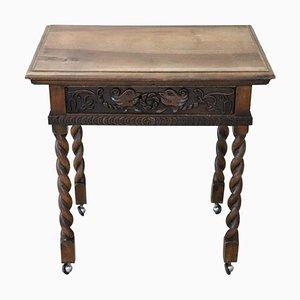 Mesa auxiliar antigua de nogal tallado, década de 1880