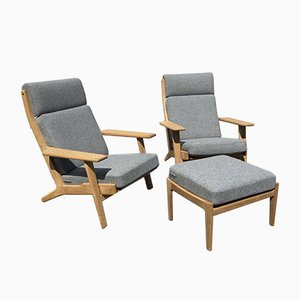 Vintage Set with 2 Lounge Chairs & Ottoman by Hans J. Wegner for Getama, 1950s