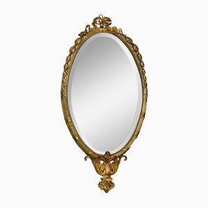 Specchio da parete ovale antico dorato