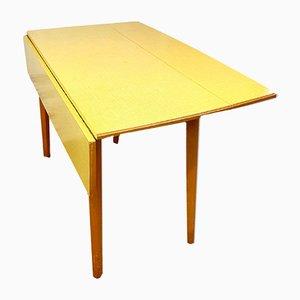 Mesa de comedor Mid-Century de formica amarilla, años 60