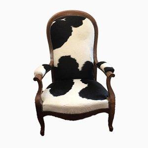 Poltrona antica in pelle di mucca
