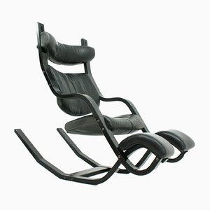 Leather and Wood Gravity Balans Lounge Chair from Stokke, 1980s