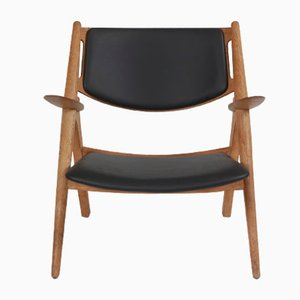 Danish Leather and Oak Lounge Chair by Hans J. Wegner for Carl Hansen & Søn, 1970s