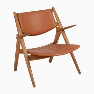 Danish Leather and Oak Lounge Chair by Hans J. Wegner for Carl Hansen & Søn, 1976