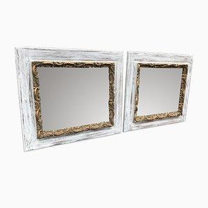 Espejos franceses antiguos de madera dorada. Juego de 2