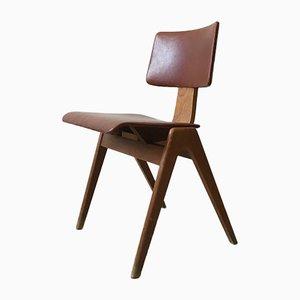 Sedia in quercia ed ecopelle di Robin Day per Hillestack, anni '50