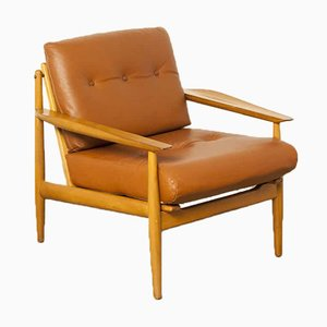 Mid-Century Armlehnstuhl aus Leder und Holz, 1950er