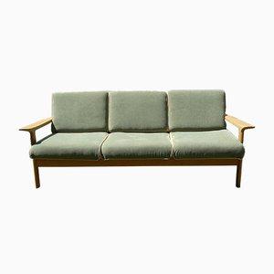 Sofá de tres plazas danés de cuero y roble, años 70