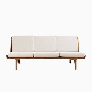 Mid-Century Walnut Studio Sofa by Carl Gustaf Hiort af Ornäs for Puunveisto Oy, 1950s