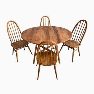 Juego de comedor vintage de roble con 4 sillas de Lucian Ercolani para Ercol