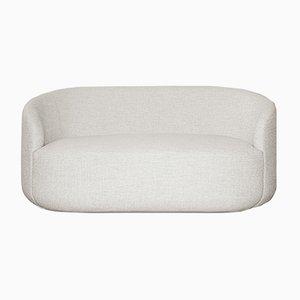 Sofá Cottonflower curvado de tela blanca de Daniel Nikolovski e Danu Chirinciuc para KABINET