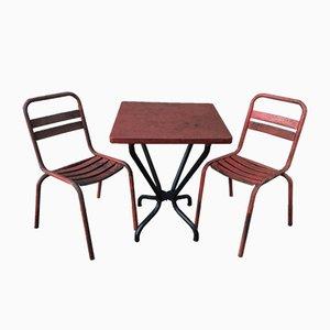 Juego de mesa y sillas de jardín industrial de hierro de Tolix, años 60