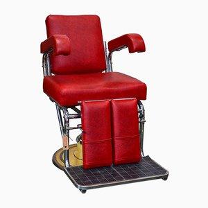 Silla de barbero vintage roja, años 60