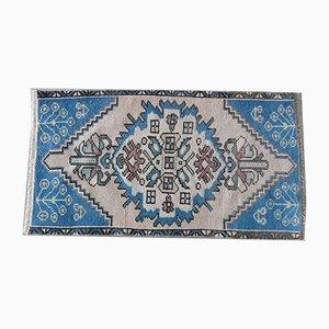 Kleiner pastellblauer Vintage Teppich