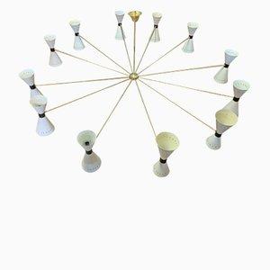 Lámpara de araña italiana Mid-Century de latón con 24 luces de Stilnovo, años 50