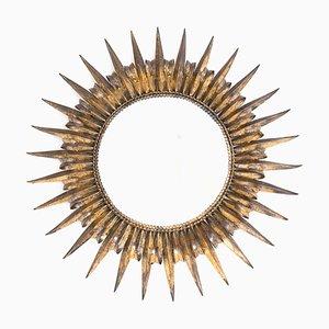 Specchio a forma di sole in ferro dorato, anni '50