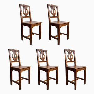 Antike neoklassizistische Esszimmerstühle aus Esche mit Lyra-Motiven, 5er Set