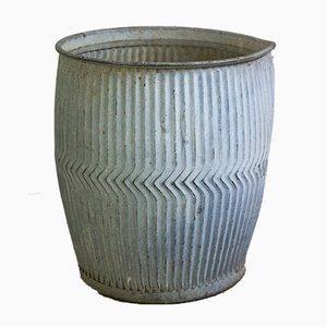 Cuba o maceta inglesa con ruedas de zinc, años 30