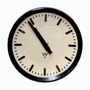 Reloj de pared industrial de baquelita, años 60