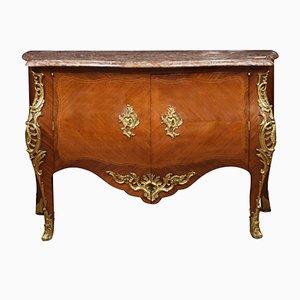 Cómoda francesa de bronce dorado y madera real, siglo XVIII