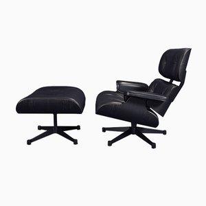 Set mit schwarzem Sessel & Fußhocker von Charles Eames für Vitra, 2000er