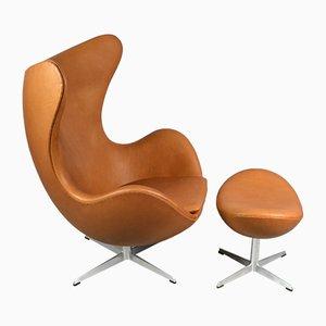 Juego de silla Egg y otomana de cuero de Arne Jacobsen para Fritz Hansen, 1967